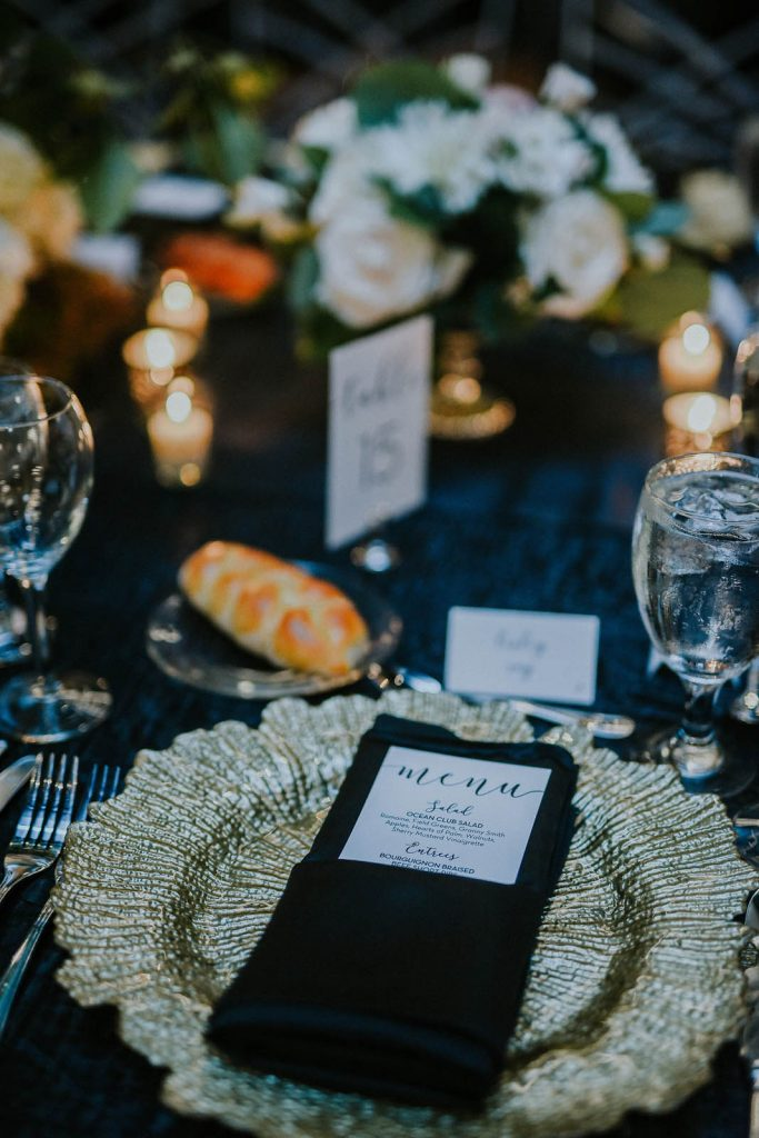 menu cards and place settings for a wedding