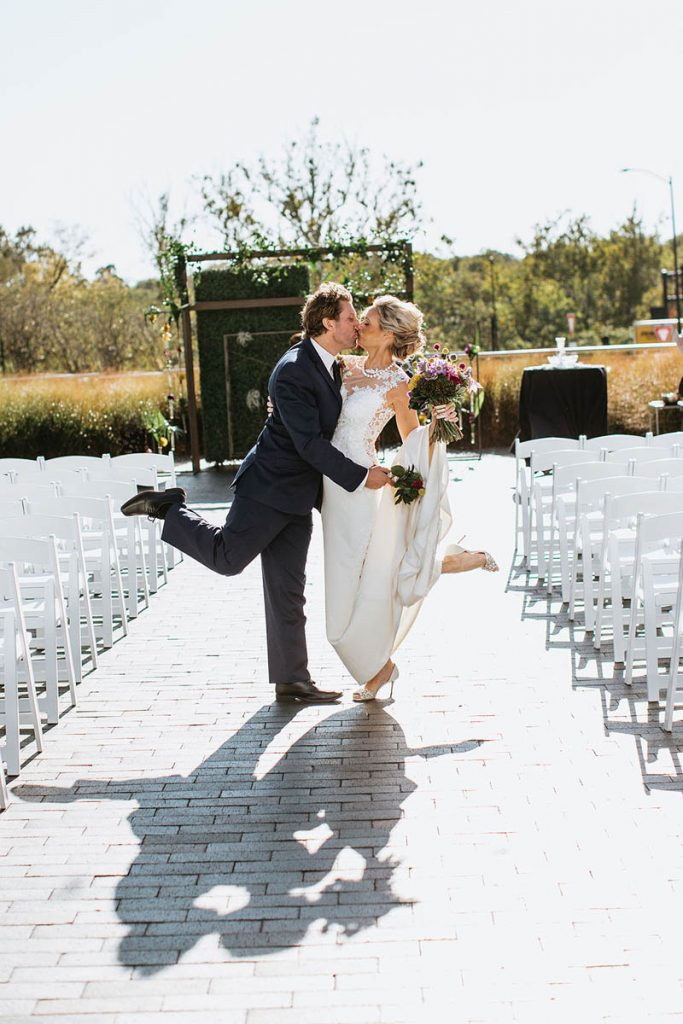 Kari and Ryan kissing at their wedding