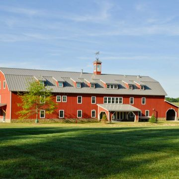 Large red barn / stable building